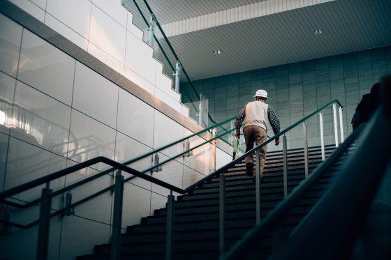 Man walks up stairs