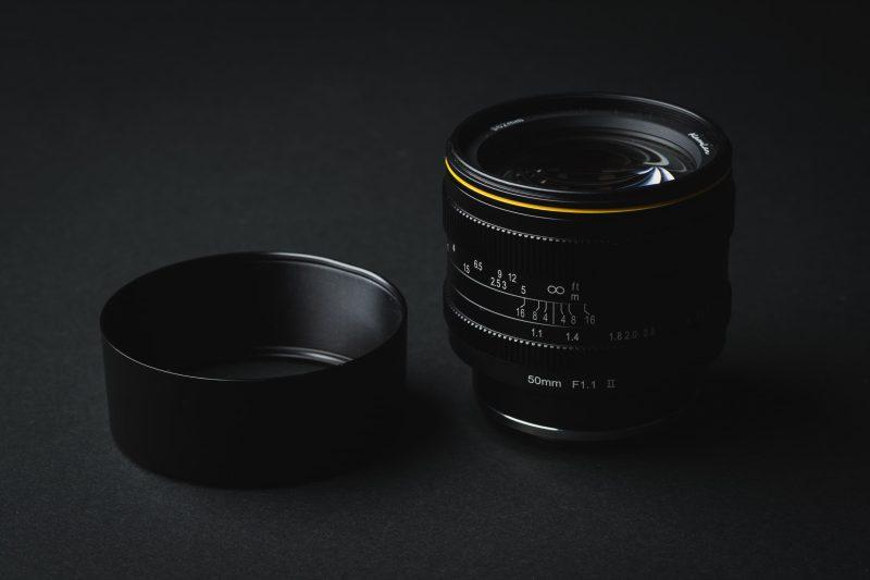 Lens with metal hood